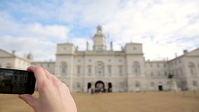 Filming palace in london with smartphone. Horse Guards London. Taking Video of the palace stock video footage