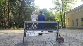 Filming in retro style. couple walking arm in arm in the park stock video footage