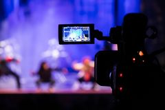Filming the show from the auditorium. LCD viewfinder on the camcorder. Theatrical performance. The actors on stage Royalty Free Stock Photos