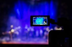 Filming the show from the auditorium. LCD viewfinder on the camcorder. Theatrical performance. The actors on stage Royalty Free Stock Image