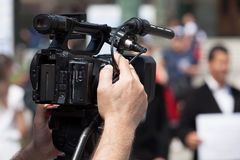 Filming street protest using video camera Royalty Free Stock Photos