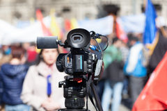 Filming street protest using a video camera. Filming demonstration with a video camera Stock Photos