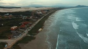 Filming the waves and the beach in a wonderful place, Ribanceira beach stock video