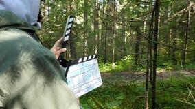 Filmklep in bosclapperboard in bosfilm die op bosgebieden schieten stock afbeeldingen