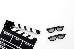 Filmmaker accessories. Clapperboard and glasses on white background top view copyspace. Filmmaker accessories. Clapperboard and glasses on white background top Royalty Free Stock Photos