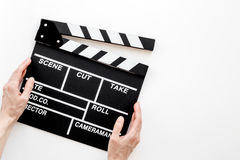 Filmmaker accessories. Clapperboard on white background top view copyspace. Filmmaker accessories. Clapperboard on white background top view Stock Photography