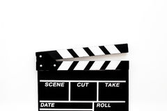 Filmmaker accessories. Clapperboard on white background top view copyspace. Filmmaker accessories. Clapperboard on white background top view Royalty Free Stock Photo