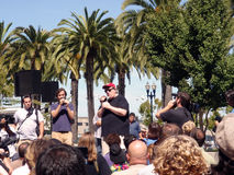 Filmmaker Michael Moore speaks to a crowd. Filmmaker Michael Moore speaks in front of crowd at Justin Herman Plaza in San Francisco to promote a new movie and Royalty Free Stock Images