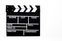 Filmmaker profession. Clapperboard on white background top view.  Stock Image