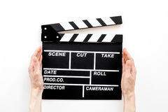 Filmmaker profession. Clapperboard on white background top view.  Stock Photography