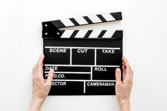 Filmmaker profession. Clapperboard on white background top view.  Royalty Free Stock Photos