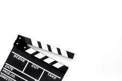 Filmmaker profession. Clapperboard on white background top view copyspace. Filmmaker profession. Clapperboard on white background top view Royalty Free Stock Image
