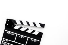 Filmmaker profession. Clapperboard on white background top view copyspace. Filmmaker profession. Clapperboard on white background top view Royalty Free Stock Images