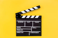 Filmmaker profession. Clapperboard on yellow background top view copyspace. Filmmaker profession. Clapperboard on yellow background top view Stock Photo