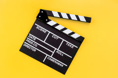 Filmmaker profession. Clapperboard on yellow background top view copyspace. Filmmaker profession. Clapperboard on yellow background top view Royalty Free Stock Photos