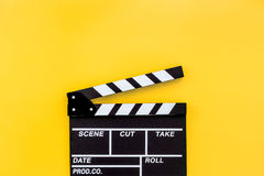 Filmmaker profession. Clapperboard on yellow background top view copyspace. Filmmaker profession. Clapperboard on yellow background top view Royalty Free Stock Images