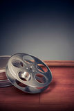 Filmmaking scene with dramatic lighting, movie reel Royalty Free Stock Photos