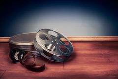 Filmmaking scene with dramatic lighting, movie reel Royalty Free Stock Photo