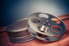 Filmmaking scene with dramatic lighting, movie reel Stock Photography