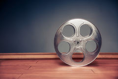 Filmmaking scene with dramatic lighting, movie reel Royalty Free Stock Images