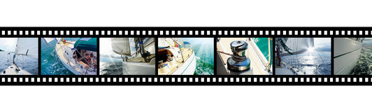 Filmremsan med bilder seglar i det öppna havet royaltyfri foto