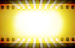 Filmremsor och ljusa strålar Arkivfoto