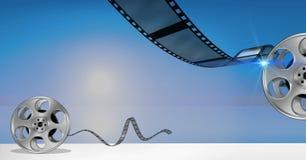Filmrollen gegen blauen Hintergrund Lizenzfreies Stockfoto