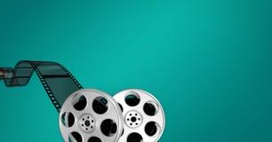 Filmrollen gegen grünen Hintergrund Stockbild