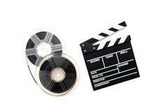 Filmrullar för tappning 8mm och bakgrund för vit för clapperbräde Royaltyfri Foto