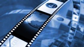 Filmrulle med aktiemarknadbilder arkivbild