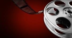 Filmrulle mot röd bakgrund Fotografering för Bildbyråer