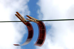 Films hanging with pegs. Films hanging via pegs Stock Photos