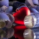 films photographiques de 35 millimètres et symbole d'amour Photographie stock libre de droits