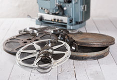 Films and reels. Several films and coils placed on an old white wooden table stock photography