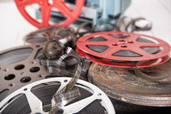 Films and reels. Several films and coils placed on an old white wooden table royalty free stock images