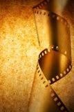 Filmstreifen über grunge Beschaffenheit Lizenzfreie Stockbilder