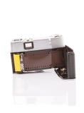 Filmstreifen innerhalb alter Retro- Kamera IV Stockbild