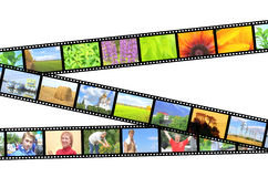 Filmstrip. Photos on filmstrip - over white Stock Photography