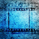 Filmstrip. Grungy background with filmstrip fragment Stock Image
