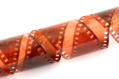 Filmstrip. Twisted colored filmstrip isolated on white background stock image