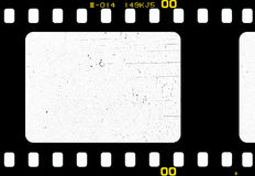 Filmstrip. Old filmstrip, scratched on white texture Royalty Free Stock Photo