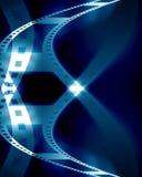 Filmstrip. Old negative filmstrip on a blue background Royalty Free Stock Image
