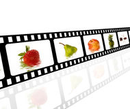 Filmstrip. The picture shows a filmstrip with different motives of fruits like apple, strawberry or pineapple Stock Photos