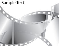 Filmstrip Abstract. Curling filmstrips are featured in an abstract background vector illustration with space for text Stock Photo