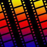 Filmstrip background. A colorful background of strips of celluloid film Stock Photos