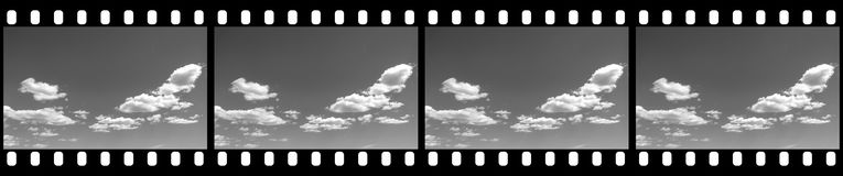 Filmstrip Cloudy Sky Background. With Blank Copy Space for Custom Content Stock Images