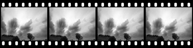 Filmstrip - Cloudy Sky. Background with Blank Copy Space for Custom Content Stock Photos