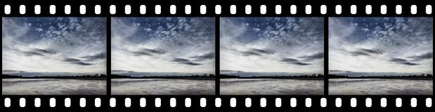 Filmstrip - Cloudy Sky. Background with Blank Copy Space for Custom Content Royalty Free Stock Photography