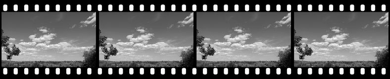 Filmstrip - Cloudy Sky. Background with Blank Copy Space for Custom Content Stock Photo
