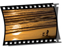 Filmstrip Frame. Cut piece of filmstrip of a travel movie on a developed negative curled at the edges stock images